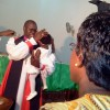 Bishop Erwau of Soroti 2 christening Sasha
